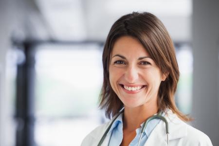 female doctor: Smiling female doctor in hospital hallway