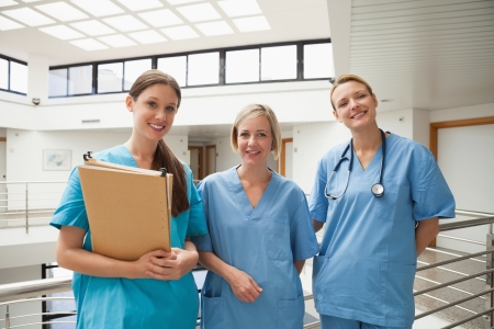 stairwell: Three smiling nurses in stairwell