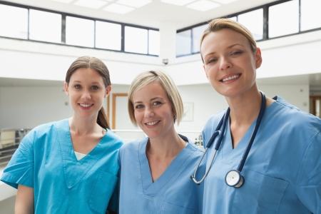 stairwell: Three happy nurses at hospital stairwell
