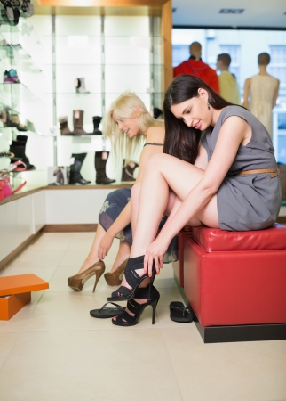 Women searching for shoes in a shop Stock Photo - 15591371
