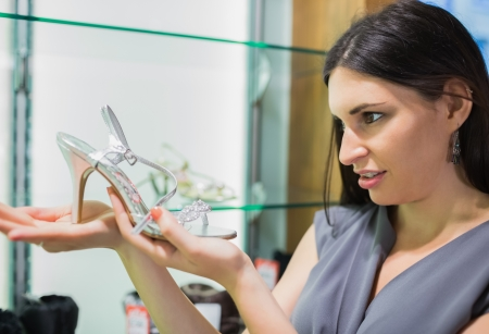 Woman looking at a shoe in a shoe store Stock Photo - 15591884