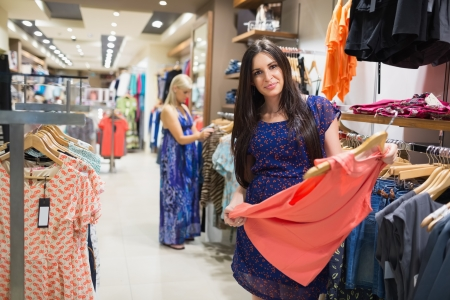 clothing store: Women looking at clothes in clothes store