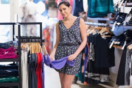 Woman looking at clothes at the shopping mall Stock Photo - 15593155
