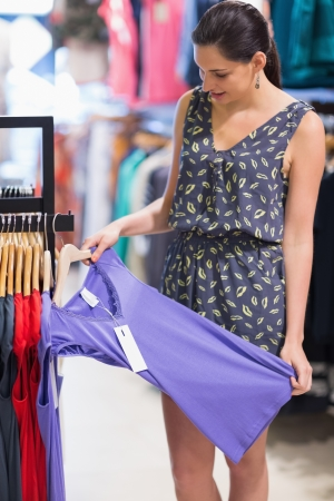 Happy woman looking at clothes at the shopping mall Stock Photo - 15593191
