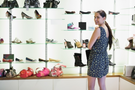 burrowing: Woman standing beside shoe display in shopping mall