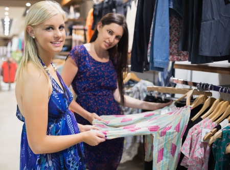 Women smiling and shopping in shopping mall Stock Photo - 15593075