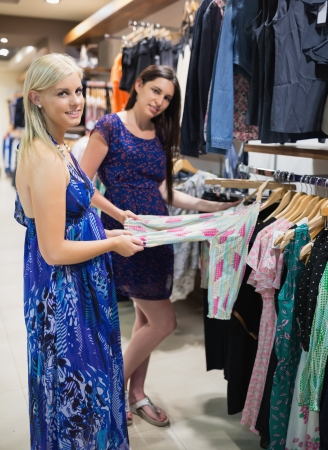 Woman and friend shopping at clothes store Stock Photo - 15584290