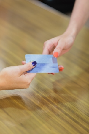 Credit card transaction between two women Stock Photo - 15593357