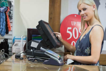 checkout counter: Woman at the till in the clothing store