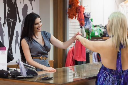 Woman making purchase in clothes shop photo