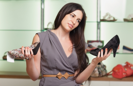 Woman choosing shoes and smiling photo