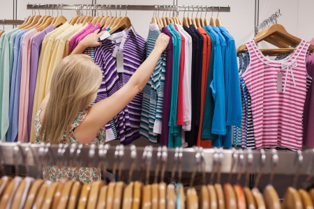 Woman is searching clothes in a boutique Stock Photo - 15592835