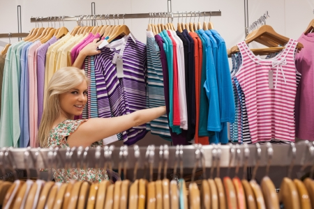 Woman looking at a clothes rack of a boutique showing clothes Stock Photo - 15593370