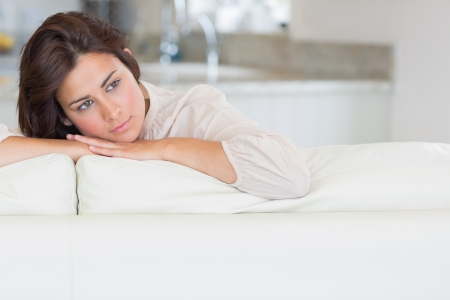 Woman relaxing on the couch and thinking Stock Photo - 15585987