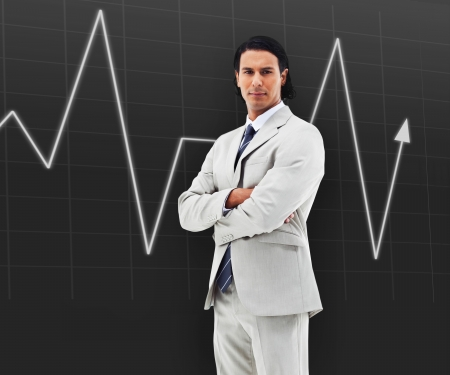 sedate: Businessman with arms crossed standing in front of a statistic