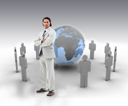 Businessman with arms crossed standing in front of a blue globe with stick figures photo