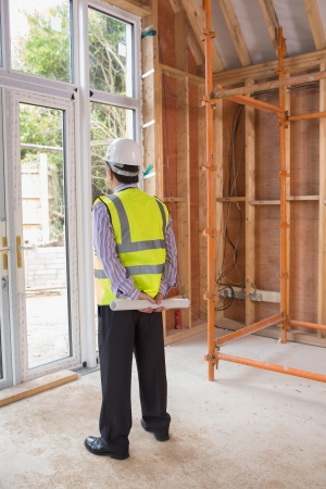 Architect standing in construction site and looking outside Stock Photo - 15584381
