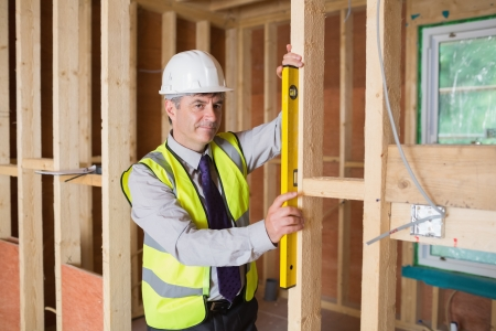 Architect measuring the door with a spirit level Stock Photo - 15584338