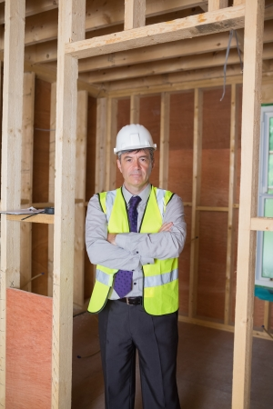 Architect with arms crossed standing in construction site Stock Photo - 15584196