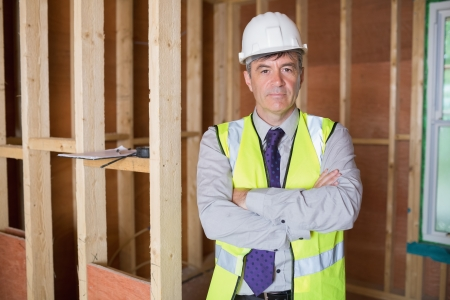 Portrait of architect with arms crossed in construction site Stock Photo - 15584224
