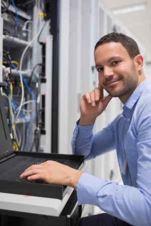 Happy man working with servers in data center Stock Photo - 15593003