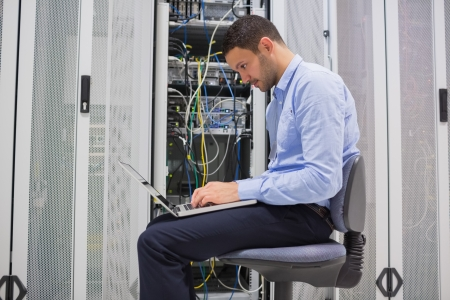Man trying to find a solution for servers in data center photo