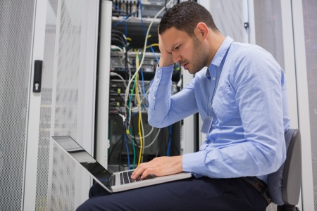 Technician becoming stressed over servers in data center photo