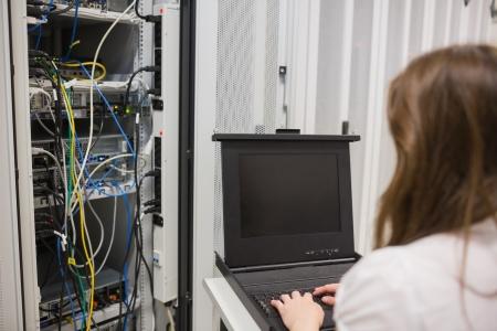 Woman storing data on server in data center Stock Photo - 15593109