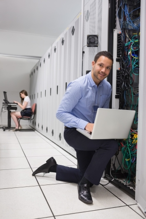 data processor: Two people doing data storage with laptops