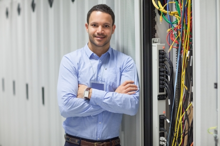 administrators: Technician standing next to the data store in hallway Stock Photo