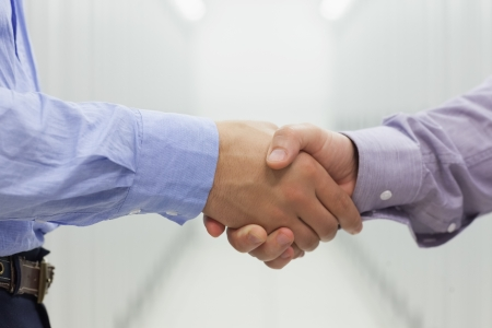 Two men shaking hands in data center Stock Photo - 15591807
