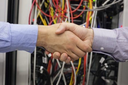Hand shake in front of wires photo