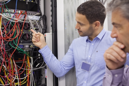 electrician: Technicians fixing wires in data center