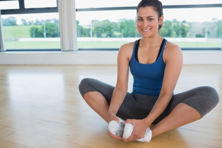 Smiling Woman Doing Bound Angle Yoga Pose On Floor Of Fitness.. Stock  Photo, Picture And Royalty Free Image. Image 15591134.
