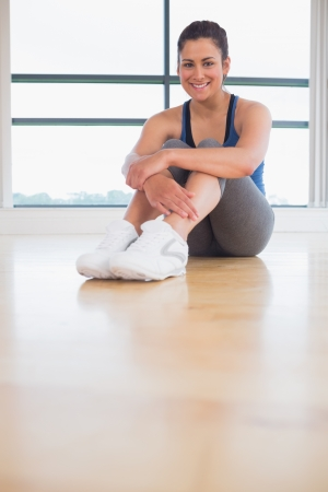 Woman smiling and sitting in fitness studio photo