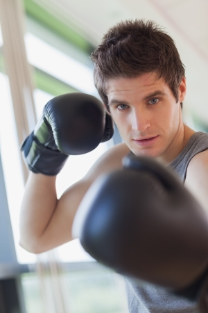 Man is boxing at the gym photo