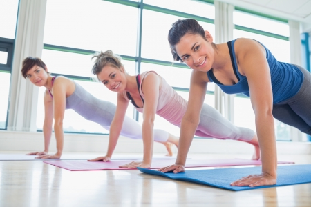 Women doing pushups at the gym photo