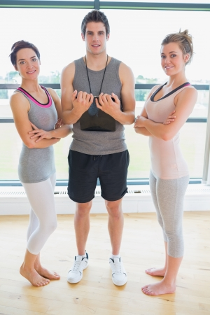 People standing at the gym smiling in fitness studio photo