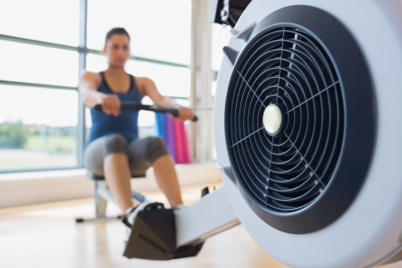 Rowing machine being used in fitness studio photo