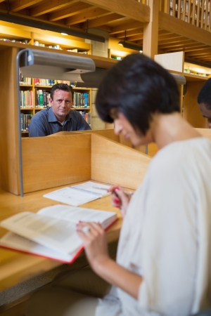 Man sitting at study desk in library Stock Photo - 15593226