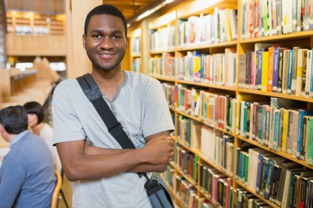 Man with arms crossed standing in library Stock Photo - 15584932
