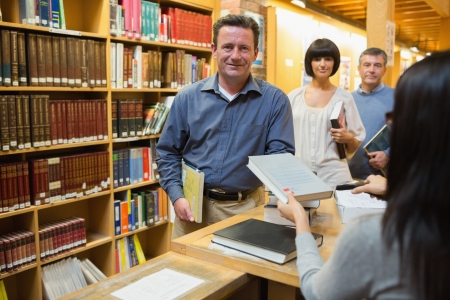 Queue at the library desk Stock Photo - 15584120