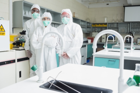 Three laboratory technicians standing in lab as a team photo