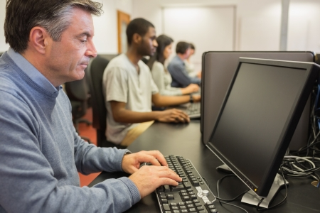 Man working at computer in computer class photo