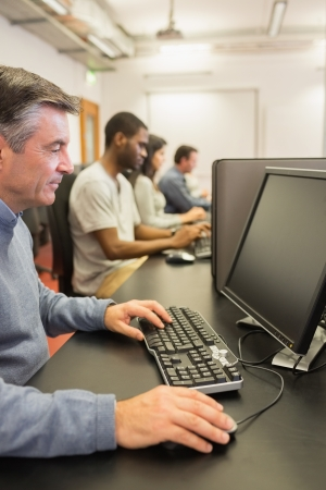 Man in computer class in college Stock Photo - 15584896