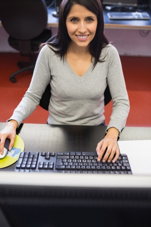 Smiling woman in computer class in college Stock Photo - 15568366