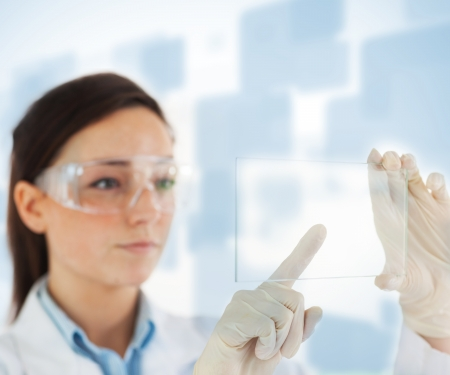 femal: Femal lab technician selecting blank pane from hologram