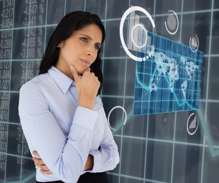 Woman standing thinking arms crossed looking at world map hologram Stock Photo - 15568369