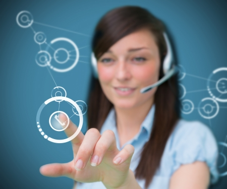 Businesswoman wearing headphones touching a symbol photo