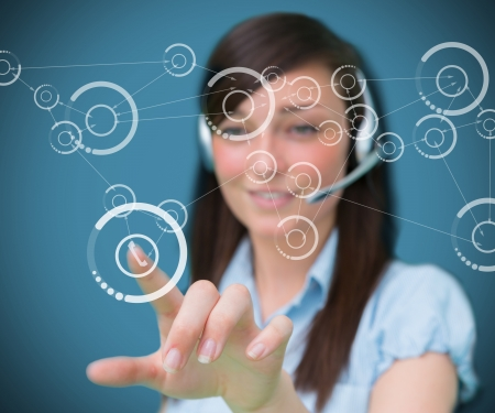 holographic: Woman selecting phone symbol from holographic digital interface